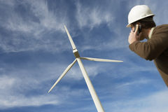 Engineer Using Mobile Phone At Wind Farm Royalty Free Stock Image