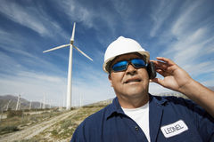 Engineer Using Mobile Phone At Wind Farm Stock Photography