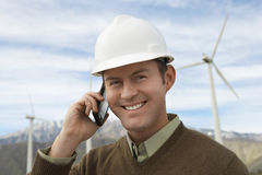 Engineer Using Mobile Phone At Wind Farm Stock Photos