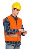 Engineer using smart phone. Royalty Free Stock Photos
