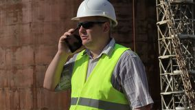 Engineer using smartphone at outdoor near tank stock footage