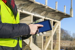 Engineer using tablet near the bridge in winter Royalty Free Stock Photos