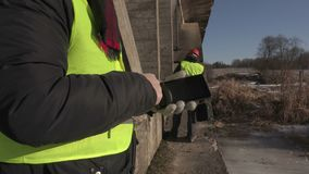 Engineer using tablet PC under the bridge. In winter day stock footage