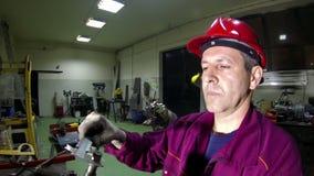 Engineer Using Vernier Caliper. Engineer at work with vernier caliper in factory workshop.HD1080p stock footage
