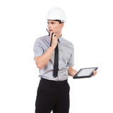 Engineer using walkie talkie. Royalty Free Stock Image