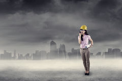 Engineer using walkie talkie outdoors Royalty Free Stock Image