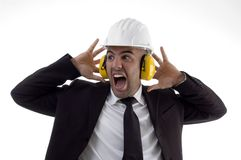 Engineer wearing earplugs Stock Photo