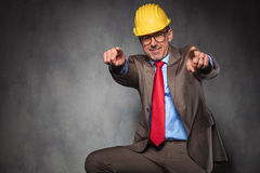 Engineer wearing helmet and glasses while pointing fingers Royalty Free Stock Photography