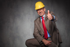 Engineer wearing helmet and glasses showing thumbs up Stock Image