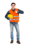 Engineer wearing reflective clothing and showing thumb up. Royalty Free Stock Photos