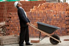 Engineer with wheel-barrow Royalty Free Stock Image