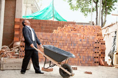Engineer with wheelbarrow Royalty Free Stock Images