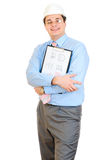 An engineer with white hard hat holding clipboard Royalty Free Stock Image