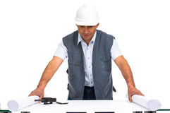 Engineer with white helmet and blueprints Stock Photography
