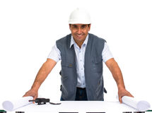 Engineer with white helmet and blueprints Stock Images
