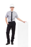 Engineer with a white placard Royalty Free Stock Photos