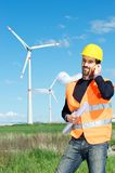 Engineer in Wind Turbine Power Generator Station Stock Photo