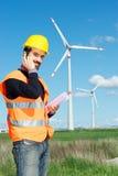 Engineer in Wind Turbine Power Generator Station Stock Image