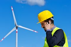Engineer in Wind Turbine Power Generator Station. Technician Engineer in Wind Turbine Power Generator talk at phone Station, Italy Stock Images