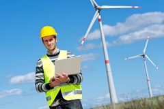 Engineer in Wind Turbine Power Generator Station royalty free stock photos