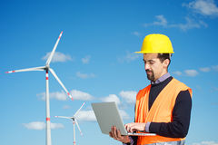 Engineer in Wind Turbine Power Generator Station royalty free stock photo