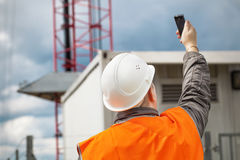 Free Engineer With The Cell Phone Royalty Free Stock Photo - 33027065