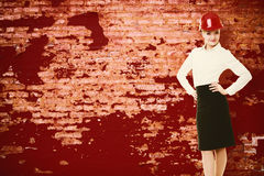 Engineer woman architect in red safety helmet Royalty Free Stock Image