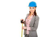 Engineer woman holding tape measure in hand. Royalty Free Stock Image