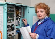 Engineer  woman in machine room (elevator) . Royalty Free Stock Image