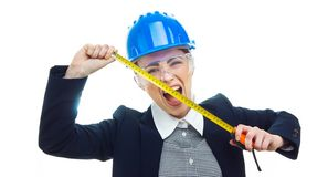 Engineer woman over white background. Astonished or shocked engineer woman with measure tape have a idea and screaming, isolated on white background.Close-up of Stock Image