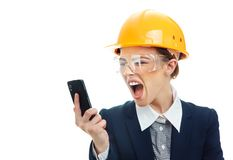Engineer woman over white background. Rage engineer woman screaming or yelling on phone, isolated on white background.Close-up of female contractor or Stock Photography