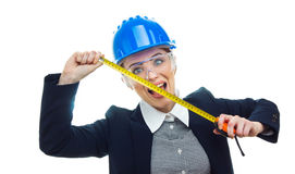 Engineer woman over white background. Surprised engineer woman with measure tape have a idea and screaming, isolated on white background.Close-up of female Royalty Free Stock Photography
