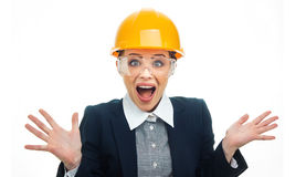 Engineer woman over white background. Surprised engineer woman screaming or yelling, isolated on white background.Close-up of female businesswoman or Stock Image