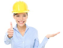 Engineer woman showing thumbs up and product stock image