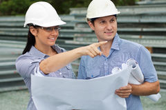 Engineer woman shows around the on site Stock Photos