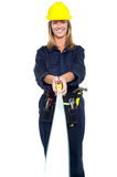 Engineer woman stretching measuring tape Royalty Free Stock Images