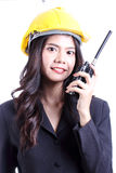 Engineer woman talking with a walkie talkie Royalty Free Stock Photography