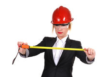 Engineer woman with tape measure Stock Image