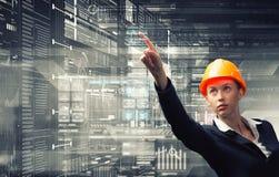 Engineer woman using virtual panel . Mixed media Royalty Free Stock Image