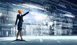 Engineer woman using virtual panel Stock Image