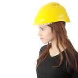 Engineer woman in yellow helmet Stock Photography