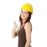 Engineer woman in yellow helmet Stock Image