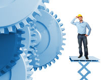 Engineer at work. And blue gear 3d Stock Image