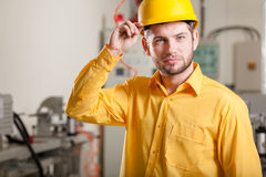 Engineer during work. Young engineer in factory during his job Royalty Free Stock Photo