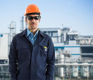 Engineer at work with factory background Stock Image