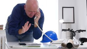 Engineer Work in Office Room Talking technical Issues on Telephone stock video footage