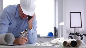 Engineer Work in Office Talk to Mobile Technical Issues and Take Notes.  stock video footage
