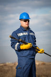 Engineer work in oil refinery Royalty Free Stock Images