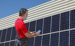 Solar energy, worker and panels Stock Photo