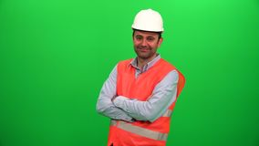 Engineer worker crossing his arms and smiling on green screen. stock footage